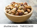 assorted mixed nuts in bowl on... | Shutterstock . vector #768322600