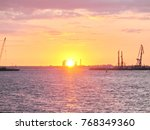 sunset sea cranes   Shutterstock . vector #768349360
