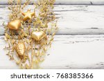 golden branch and toys for... | Shutterstock . vector #768385366