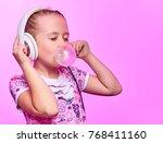 little girl with headphones... | Shutterstock . vector #768411160