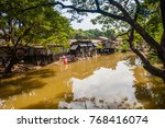 siem reap river and dwellings... | Shutterstock . vector #768416074