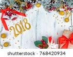 christmas wooden background... | Shutterstock . vector #768420934