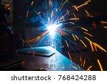 worker welding construction by... | Shutterstock . vector #768424288