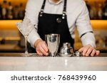 bartender in the apron and... | Shutterstock . vector #768439960