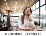 charming woman calling with... | Shutterstock . vector #768456994