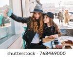 elegant brown haired joyful... | Shutterstock . vector #768469000