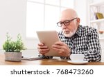 senior man reading news on... | Shutterstock . vector #768473260