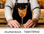 barmans hands holding a glass... | Shutterstock . vector #768478960