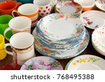the tableware is gathered... | Shutterstock . vector #768495388
