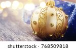 golden ball with christmas... | Shutterstock . vector #768509818