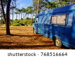 View Of A Blue Van In The...