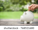 woman hand putting coin into...   Shutterstock . vector #768521680