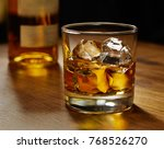 glass of whiskey on ice with... | Shutterstock . vector #768526270