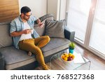 relaxed young man drinking... | Shutterstock . vector #768527368