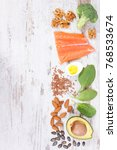 Small photo of Ingredients containing omega 3 acids, unsaturated fats and dietary fiber, healthy nutrition, lifestyle and acid diet concept, copy space for text on rustic board