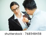 the doctor is listening to the... | Shutterstock . vector #768548458