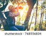 woman hiker watching through... | Shutterstock . vector #768556834