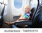 child in airplane. kid in air...   Shutterstock . vector #768592573