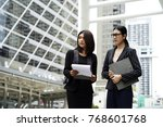 two young business woman with... | Shutterstock . vector #768601768