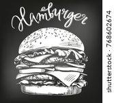 big burger  hamburger hand... | Shutterstock .eps vector #768602674