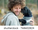 young man with curly brown hair ... | Shutterstock . vector #768602824