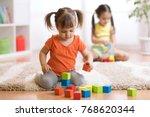 children toddlers girls play... | Shutterstock . vector #768620344