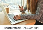 the young woman is sitting at...   Shutterstock . vector #768624784