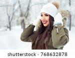 beautiful young girl outdoors...   Shutterstock . vector #768632878