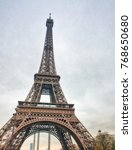 the eiffel tower on a cloudy... | Shutterstock . vector #768650680