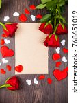 Stock photo red roses and card on a wooden background greeting card with valentine s day birthday or wedding 768651019