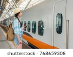 asian traveler waiting for... | Shutterstock . vector #768659308