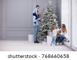 family decorating a christmas... | Shutterstock . vector #768660658