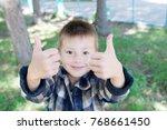 little boy show thumb up signat ... | Shutterstock . vector #768661450