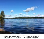 a calm quite tranquil lake with ... | Shutterstock . vector #768661864