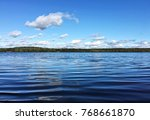 a calm quite tranquil lake with ... | Shutterstock . vector #768661870