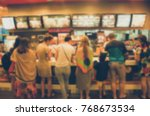 blur people order food in the... | Shutterstock . vector #768673534
