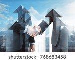 abstract arrow handshake on... | Shutterstock . vector #768683458