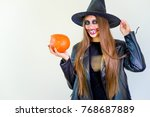 people in halloween costumes | Shutterstock . vector #768687889