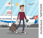 man at the airport walking with ... | Shutterstock .eps vector #768701044