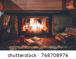 open book by the fireplace with ... | Shutterstock . vector #768708976