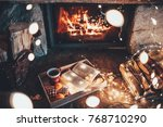 warm cozy fireplace with real... | Shutterstock . vector #768710290