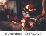 woman in woollen socks by the... | Shutterstock . vector #768711424