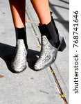 silver wedge shoes  | Shutterstock . vector #768741646