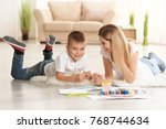 mother with cute boy painting... | Shutterstock . vector #768744634
