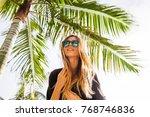 woman wearing sunglasses posing ... | Shutterstock . vector #768746836