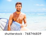 handsome man with surfboard... | Shutterstock . vector #768746839