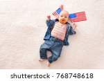 cute baby with american flags... | Shutterstock . vector #768748618