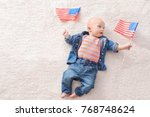 cute baby with american flags... | Shutterstock . vector #768748624