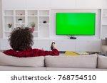 young handsome man in bathrobe... | Shutterstock . vector #768754510
