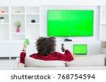 young handsome man in bathrobe... | Shutterstock . vector #768754594